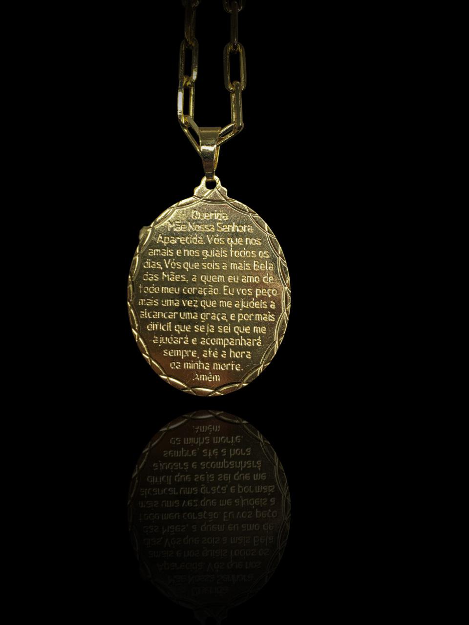 Pingente oval - oração nossa senhora  banhado a ouro 18k