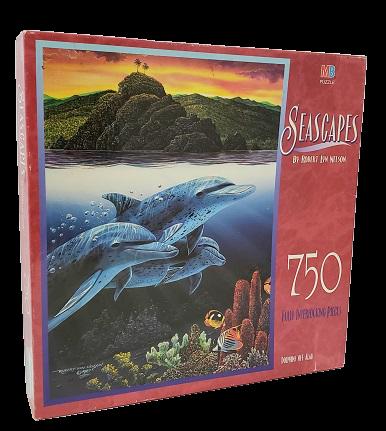Quebra Cabeça 750 peças - Milton Bradley - Dolphins off Alau