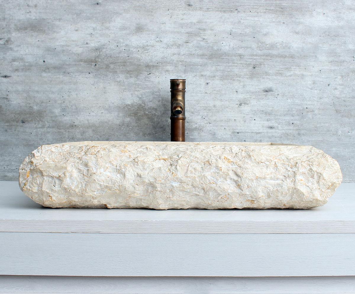 Cuba de apoio esculpida em marmore sintético crema marfil.